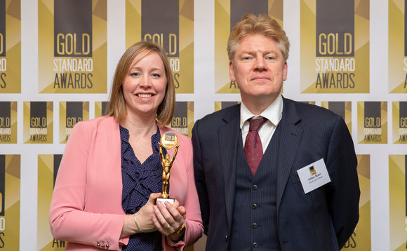 Mearns & Company managing director Catherine Bell picks up the company's Gold Standard Award from PA editor Julian Marr