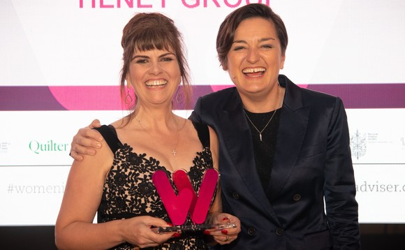 Tilney's Eliana Sydes, who was named Financial Adviser of the Year at the inaugural Women in Financial Advice Awards, receives her trophy from the evening's host, comedian Zoe Lyons