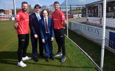 Rowley Turton IFA and director Scott Gallacher and his son Ryan, who has Ectodermal Dysplasia, with cricketers at Leicestershire Cricket Club in 2019.
